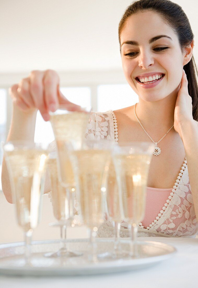 Pretty woman picking up a champagne flute