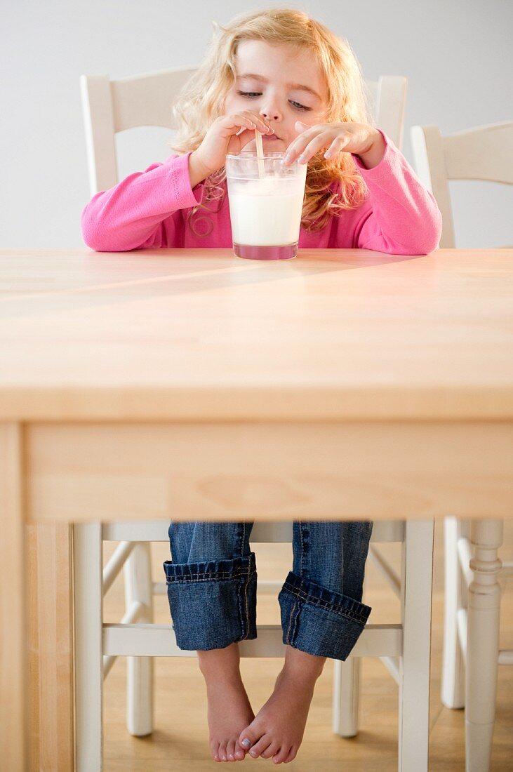 Two blond girls (20months, 4) drinking milk