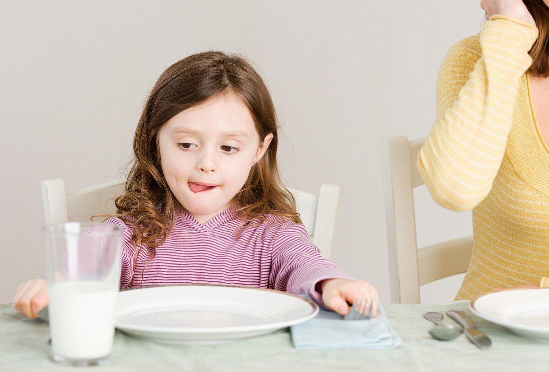 Girl sitting at dinner table