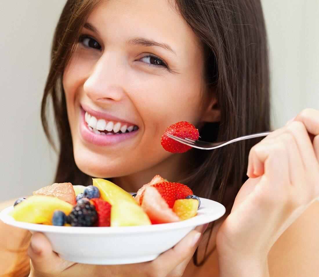 Woman eating fresh fruit