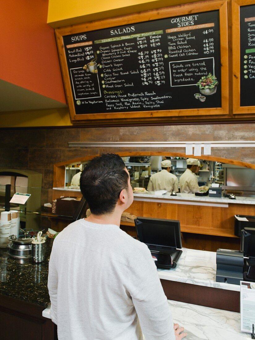 Customer reading chalkboard menu