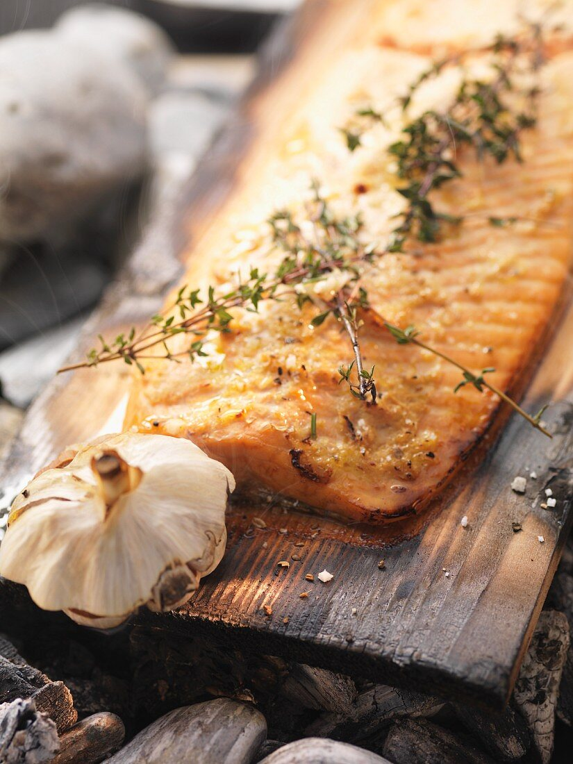 Salmon barbecued on cedar wood with thyme and garlic