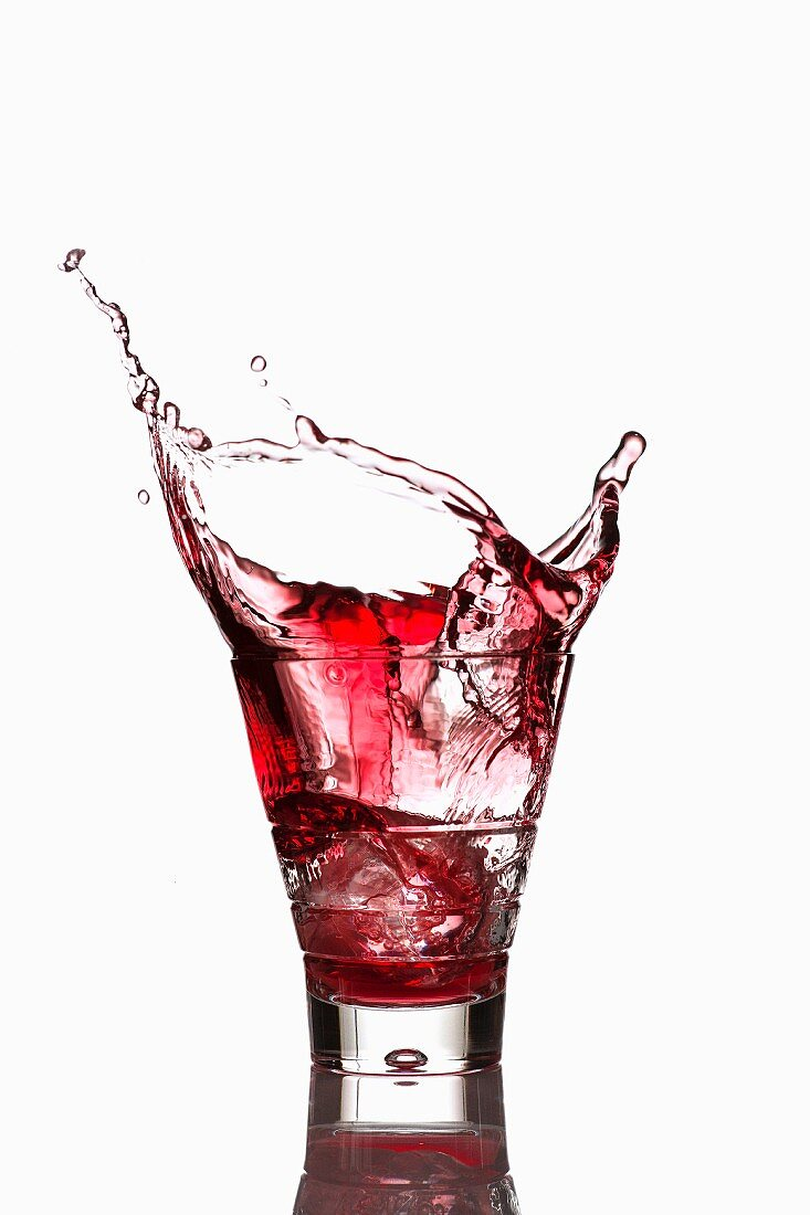 Campari spilling out a glass