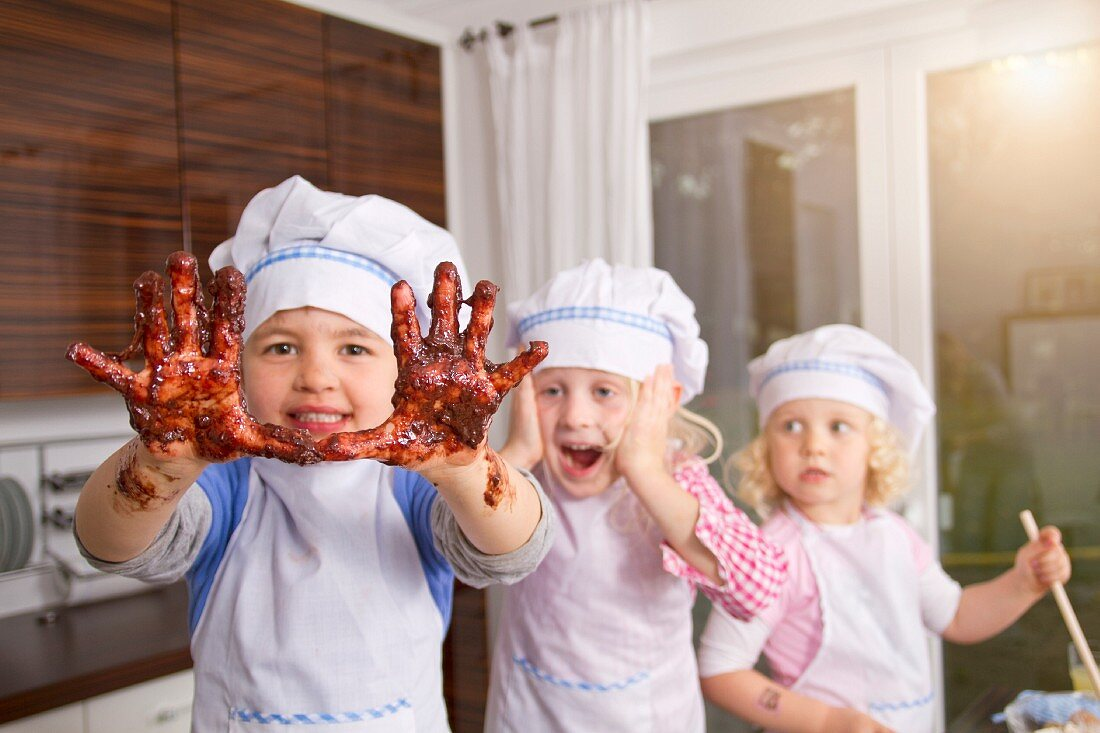 Germany, Boy hands covered with chocolate dough