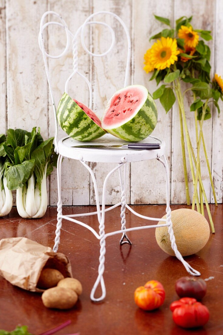 Organic Fruit and Vegetables; Halved Watermelon on a Chair