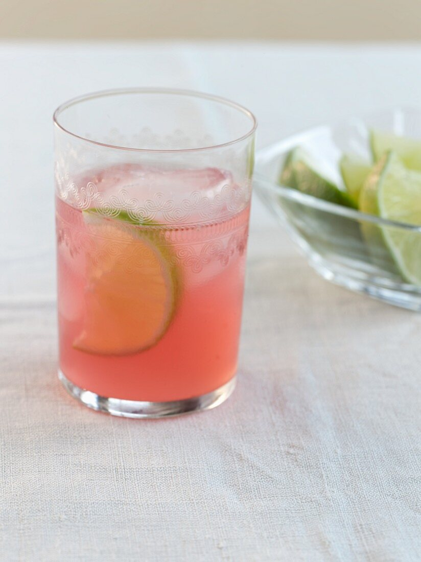Elderflower Cocktail with Lime in a a Glass with Ice