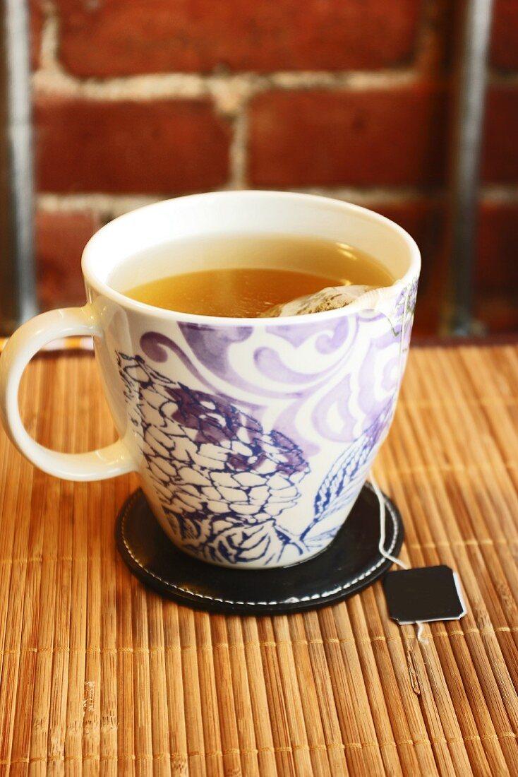 A Cup of Green Tea with a Tea Bag