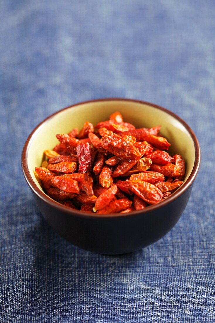 Dried chilli peppers in a small bowl