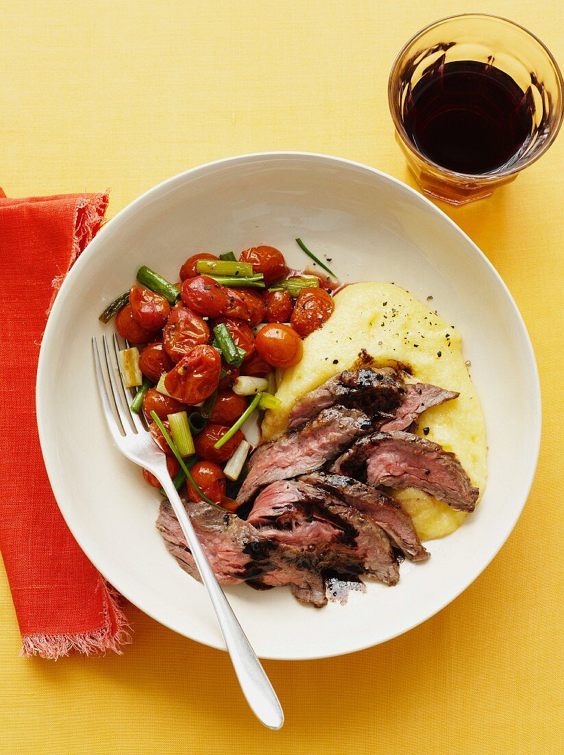 Beef steak with polenta and cherry tomatoes