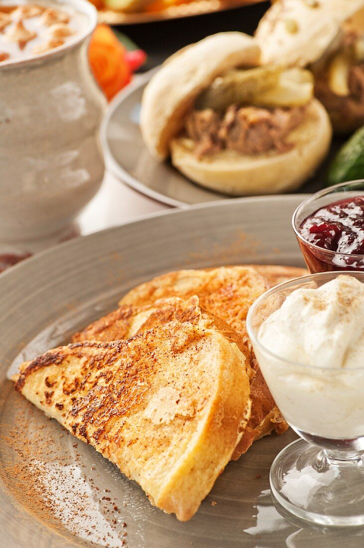 French toast with strawberry jam and cardamom cream; a filled roll and rose-hip soup in the background
