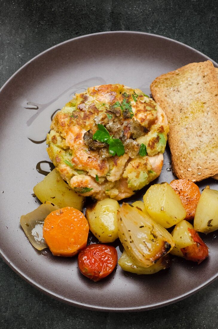 Salmon burger with pan-fried vegetables and toast