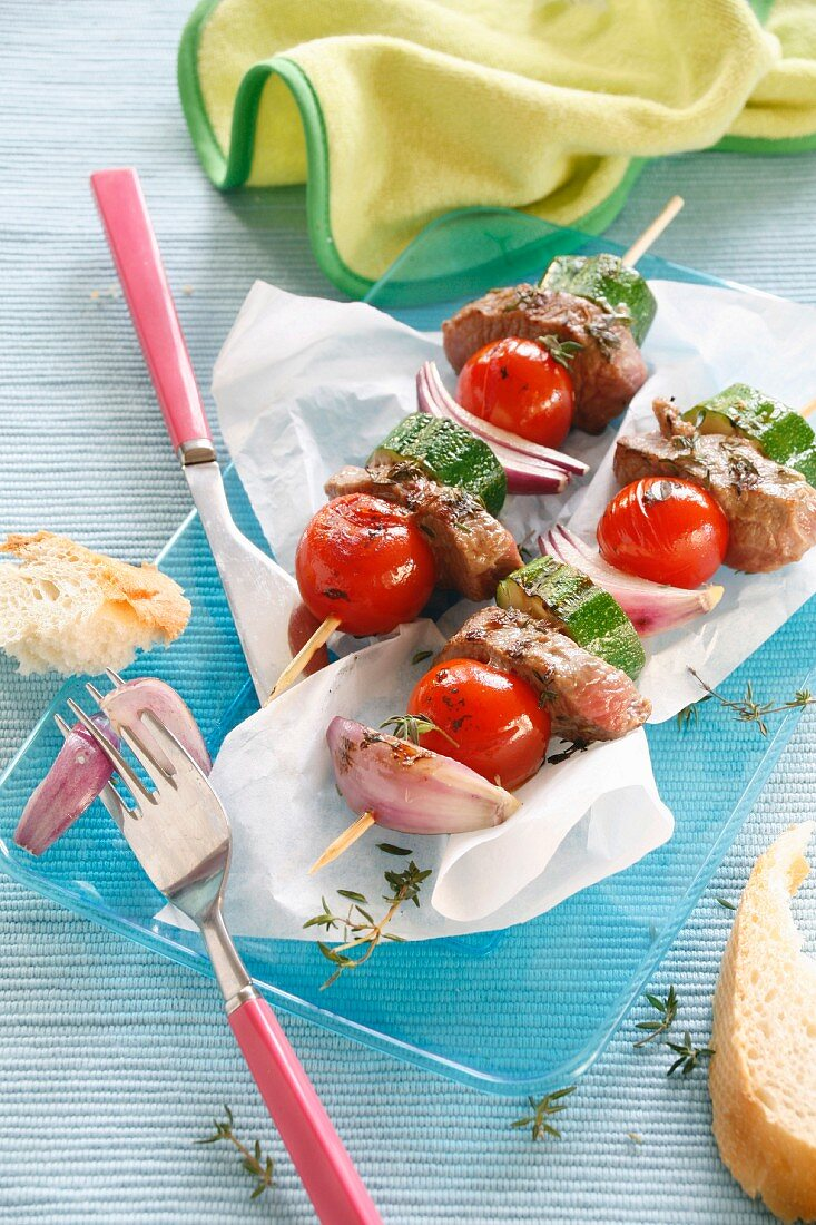 Skewers of lamb with courgette and cherry tomatoes