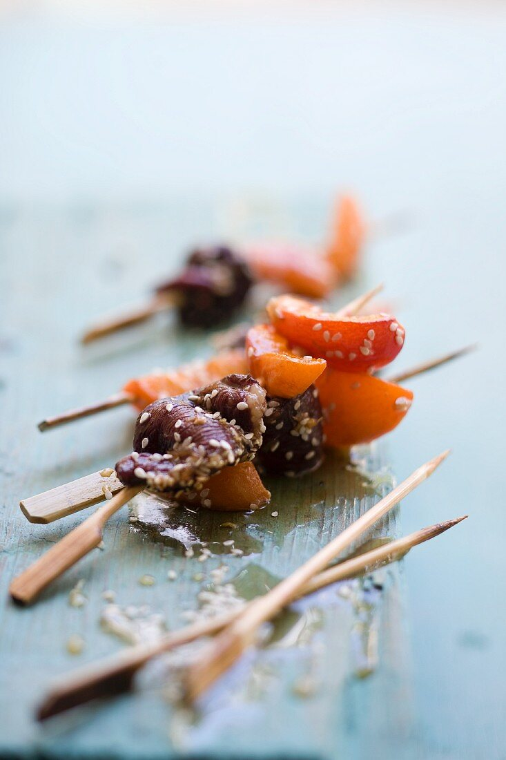 Apricot skewers with duck and sesame seeds