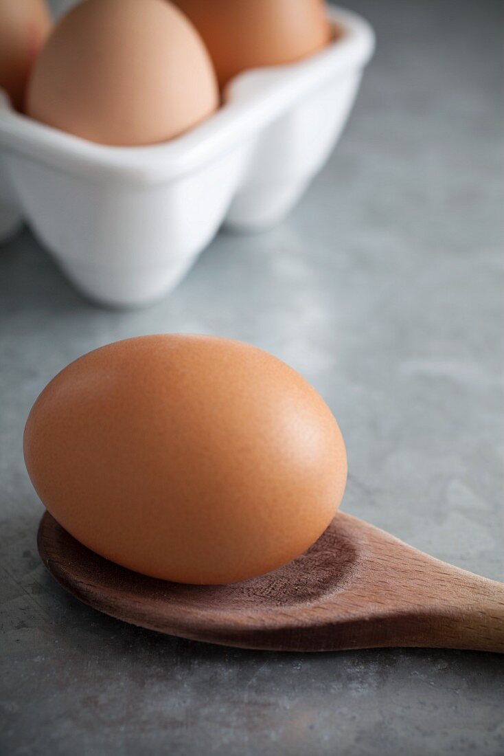 Free range egg on a wooden spoon