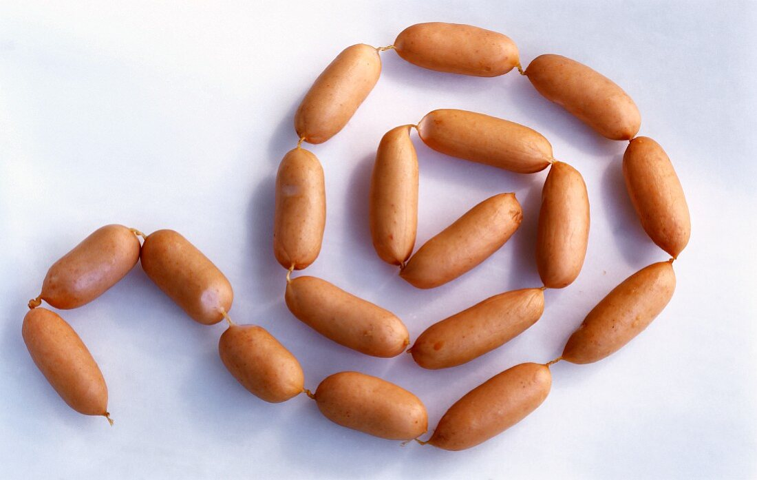A chain of cocktail sausages