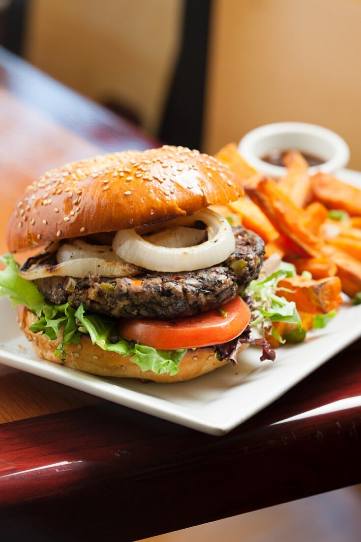 Veggie Burger with Lettuce, Tomato and Onion; Served with Sweet Potato Fries
