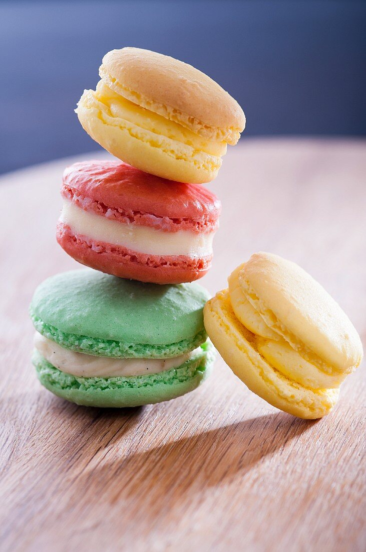 A stack of four different coloured macaroons