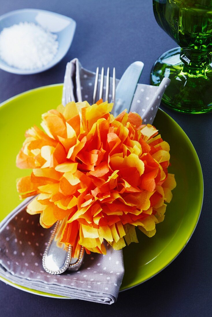 Homemade paper flowers as a napkin ring