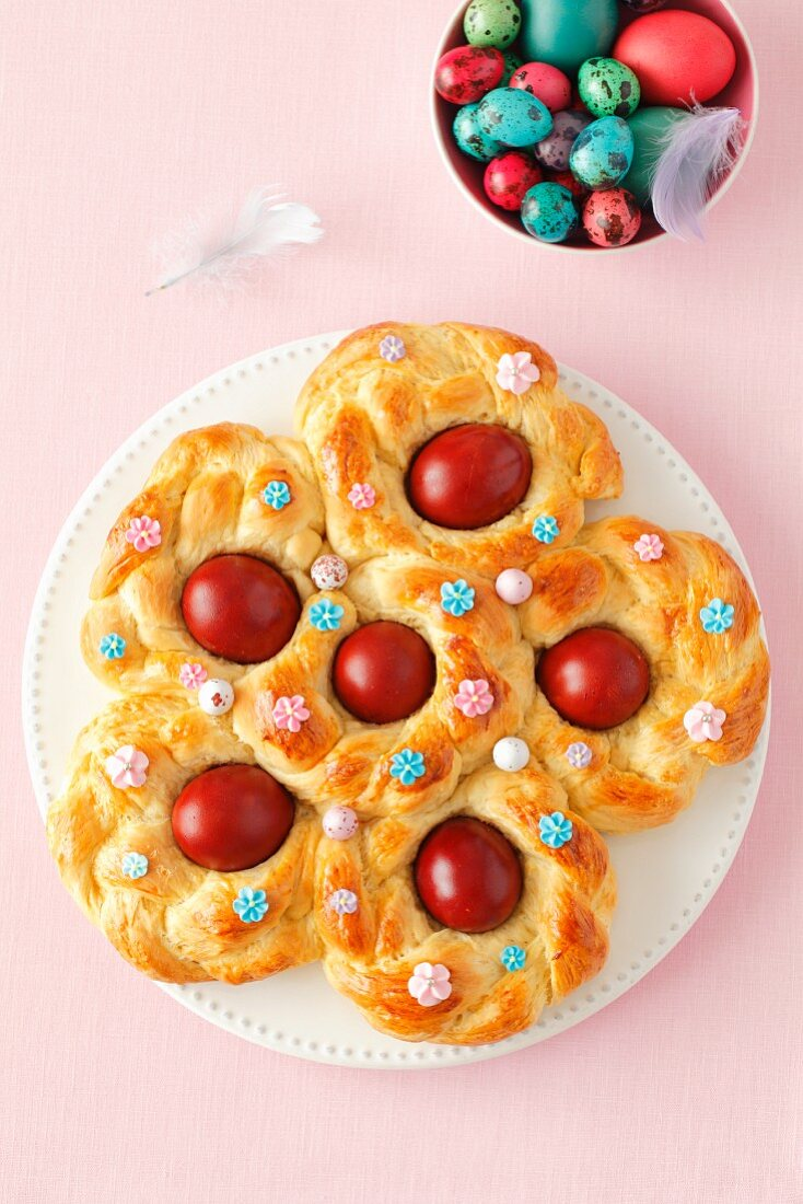 An Easter nest made from yeast-raised dough with red-coloured eggs