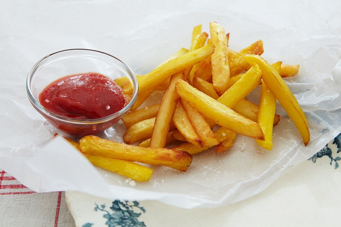 Ketchup on French fries, close-up, elevated view