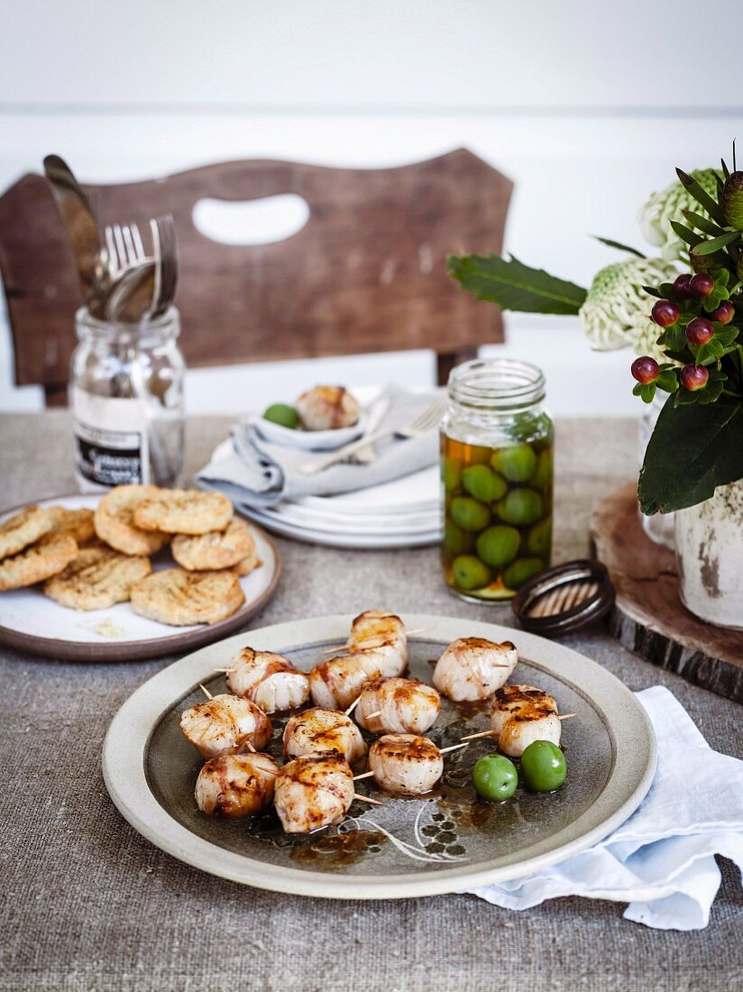 Grilled scallops wrapped in bacon with Gruyere biscuits