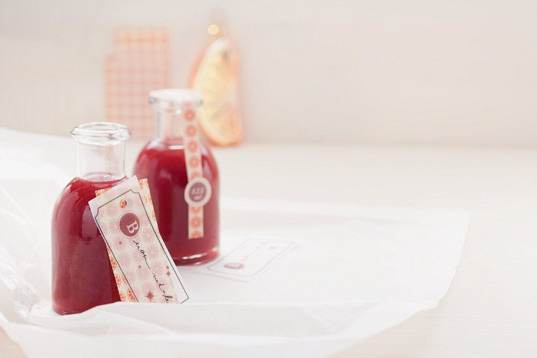 Small bottles of blood orange syrup with Campari
