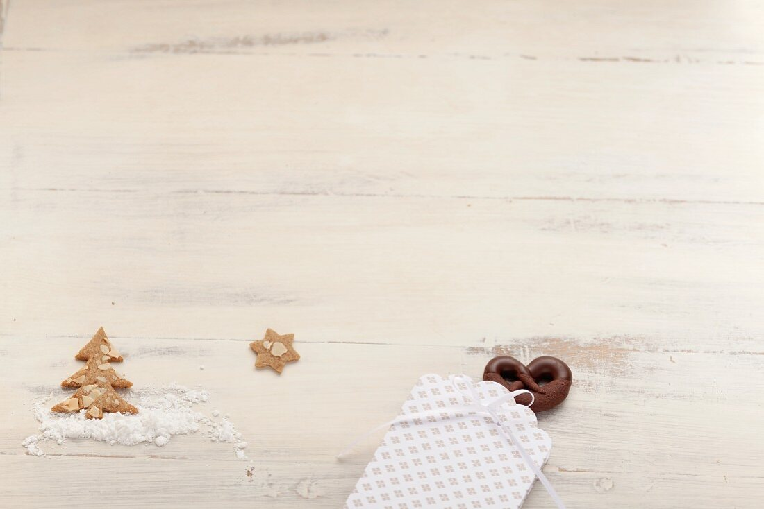 Spekulatius (German Christmas shortcrust biscuits) with almonds and chocolate pretzels with hazelnuts
