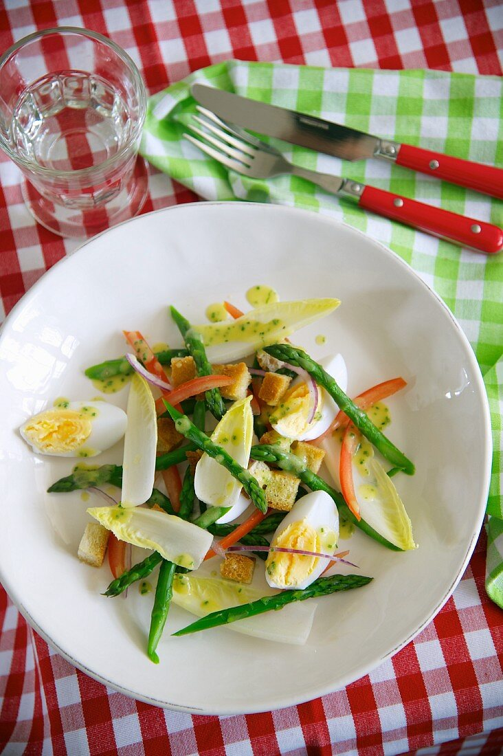 Asparagus salad with duck eggs