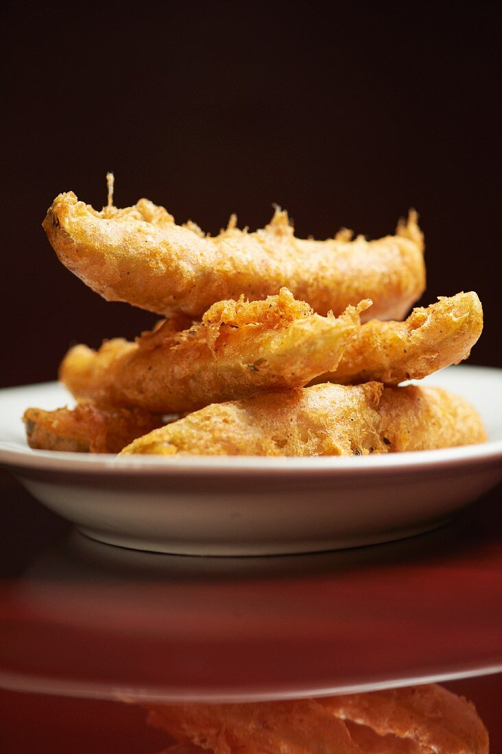 Fried Pickles Stacked on a White Plate