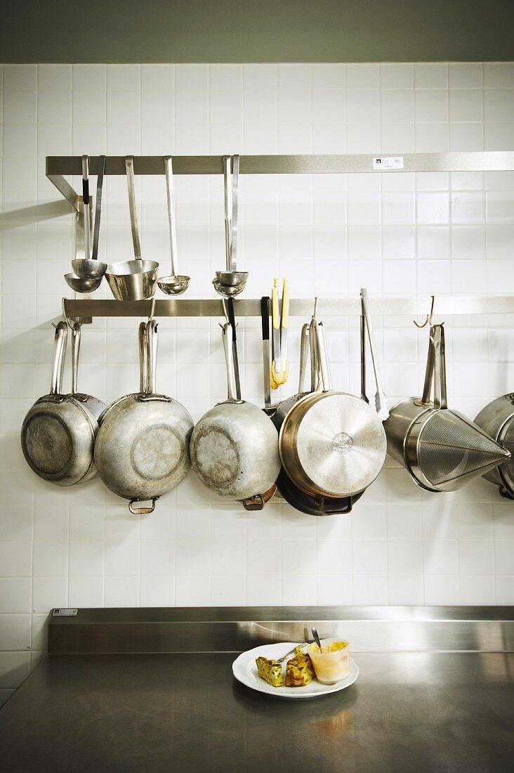 Pans Hanging in a Restaurant Kitchen