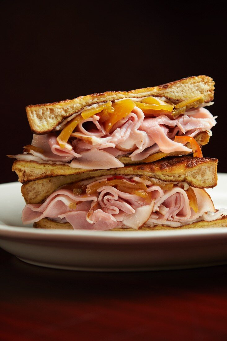 Smoked Turkey Sandwich with Melted Cheese and Peppers; Halved and Stacked