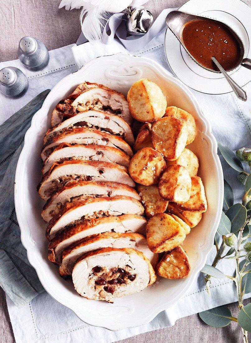 Stuffed turkey roulade with crispy roast potatoes