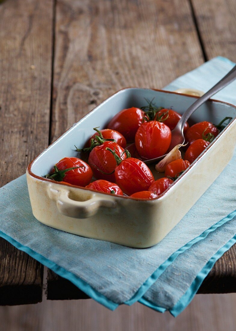 Oven-roasted tomatoes in a casserole dish