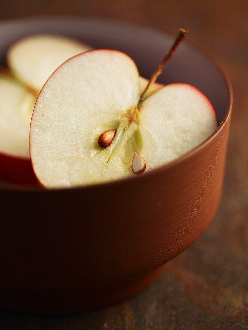 A Pink Lady apple, cut in half