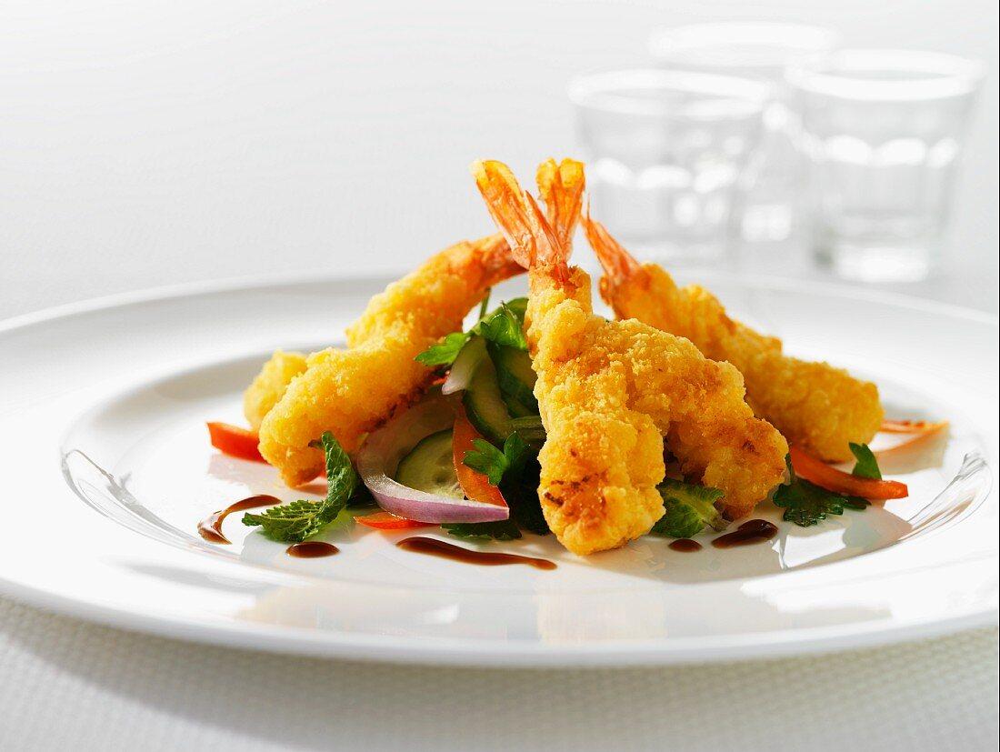 Deep-fried split prawns with salad