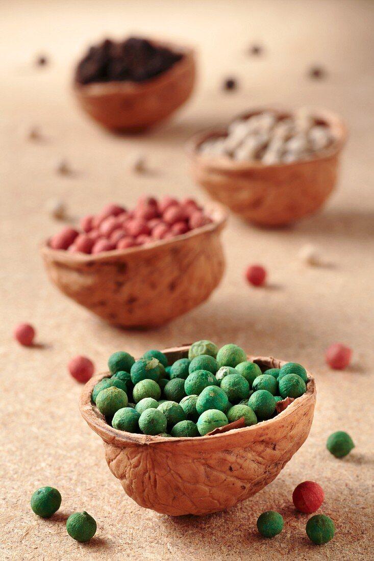 Colourful peppercorns in walnut shells