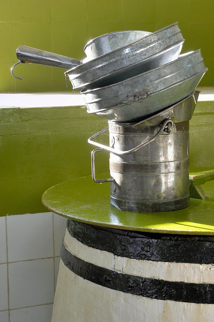 A measure and funnels on top of a cask of olive oil (Tunisia)