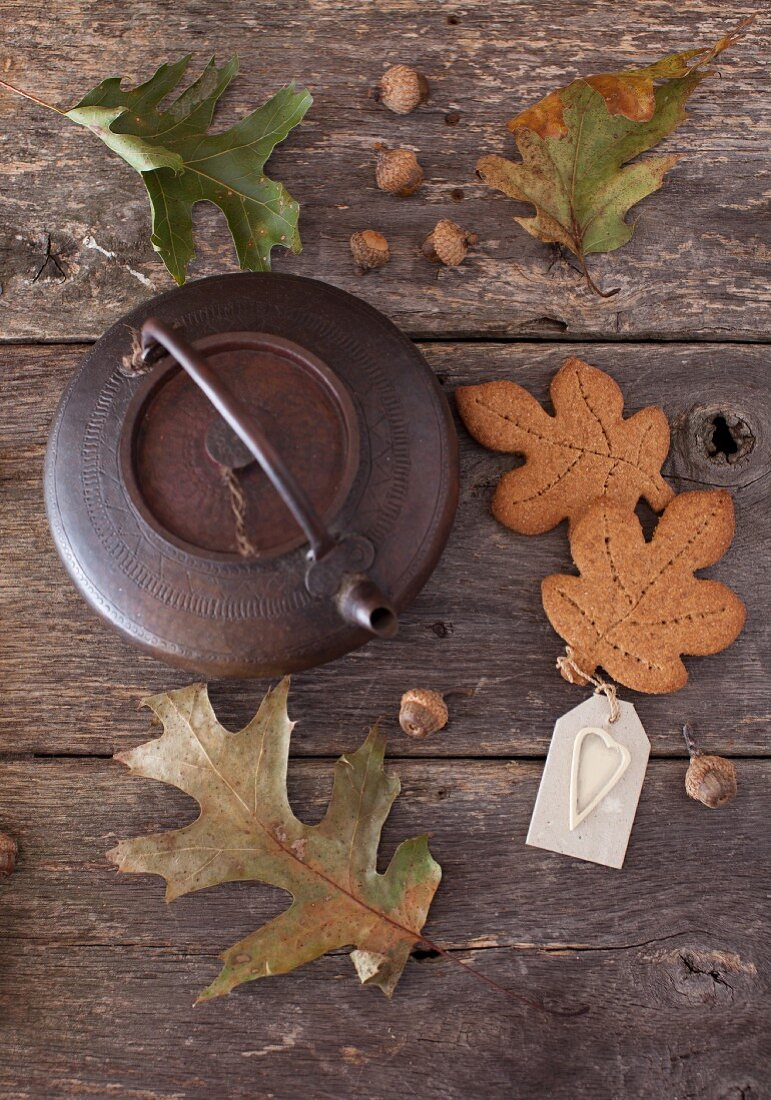Whole Wheat Maple Graham Leaf Cookies with a Tea Kettle on a Wooden Table; Leaves and Acorns