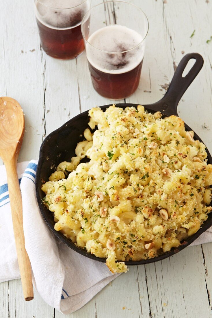 Macaroni and Cheese Made with Cremont Cheese, Onion and Parmesan Topped with Panko Cooked in a Cast Iron Skillet