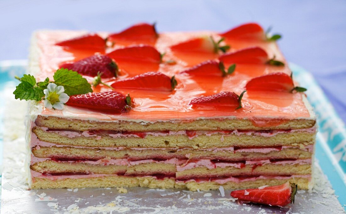 A square strawberry layer cake