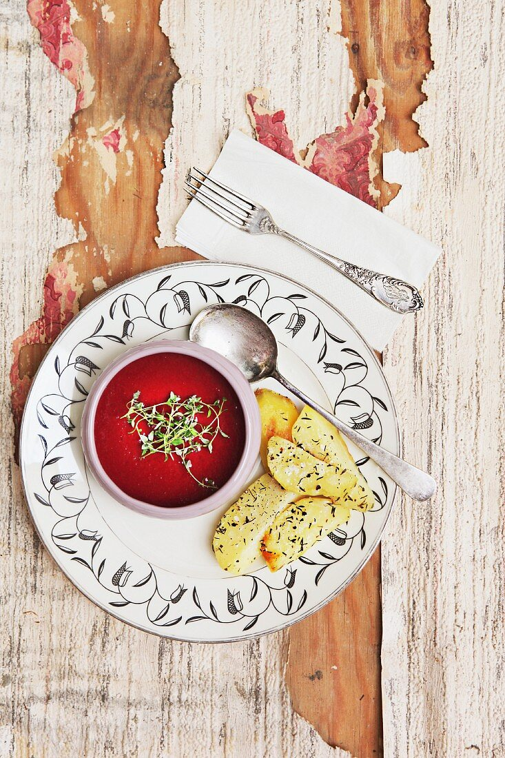Beetroot soup with thyme and potato wedges