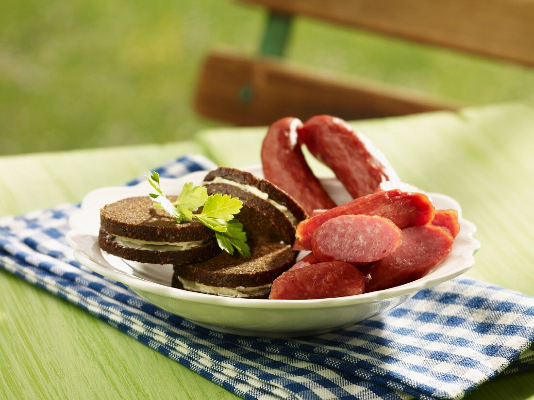 Pumpernickel sandwiches with cabanossi sausage