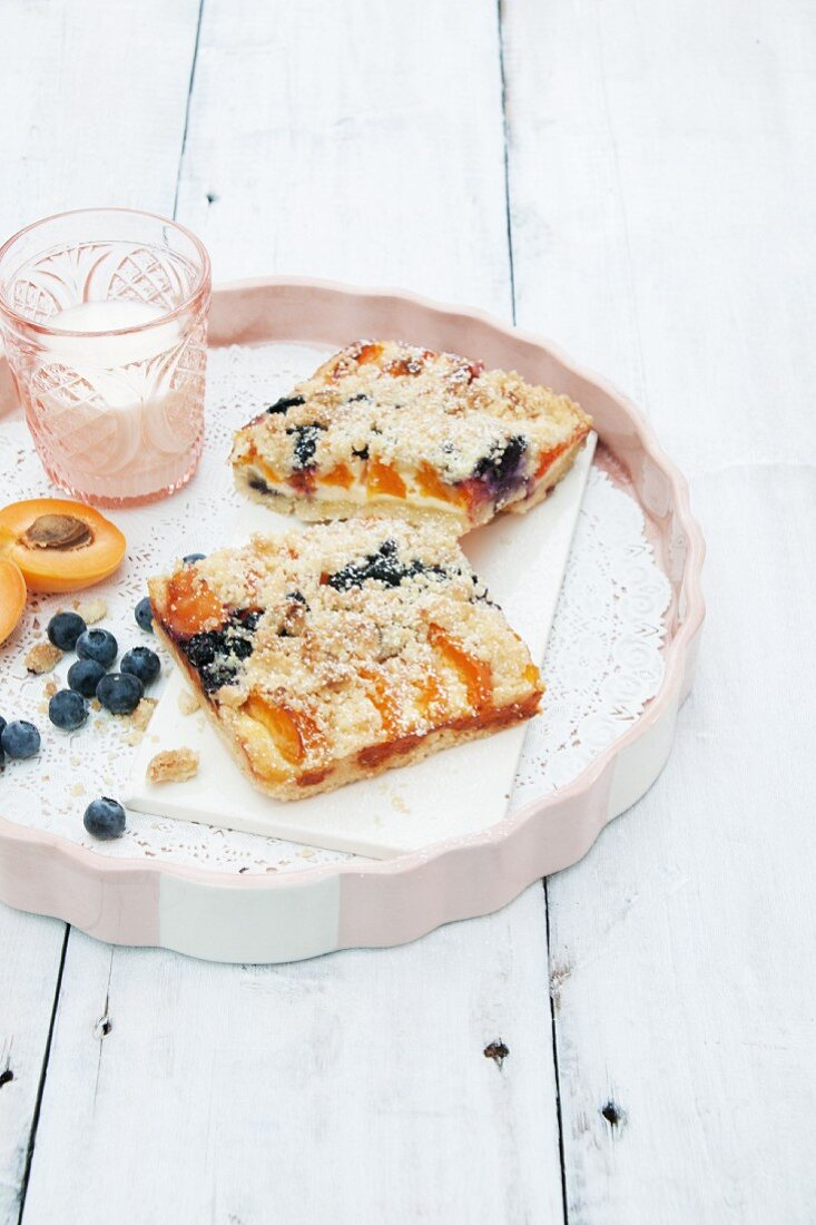 Apricot and blueberry cake and a glass of milk