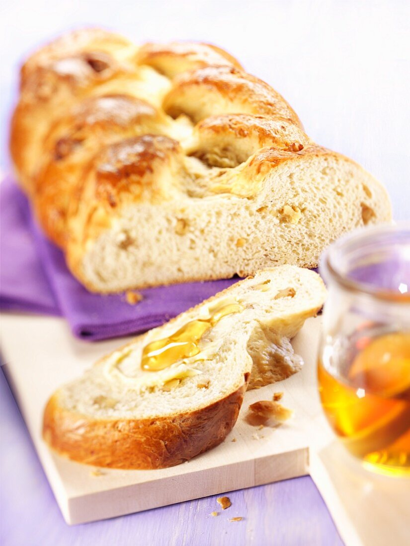 Sliced Hefezopf (sweet bread from southern Germany) with walnuts