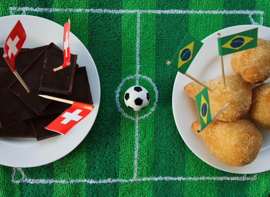 Chocolate (Switzerland) and salgadinhos (Brazil) with football-themed decoration