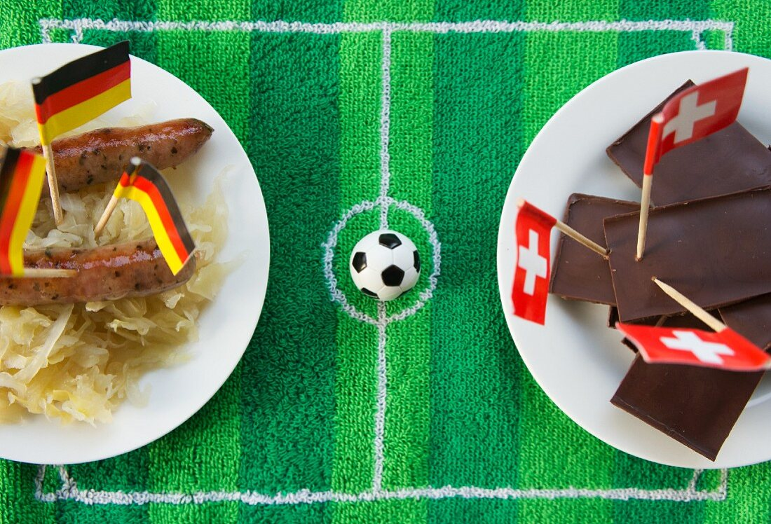 Sausages with cabbage (Germany) and chocolate (Switzerland) with football-themed decoration