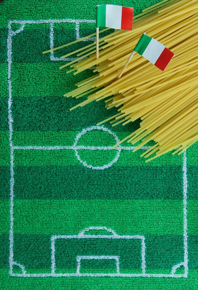 Spaghetti with an Italian flag and football-themed decoration