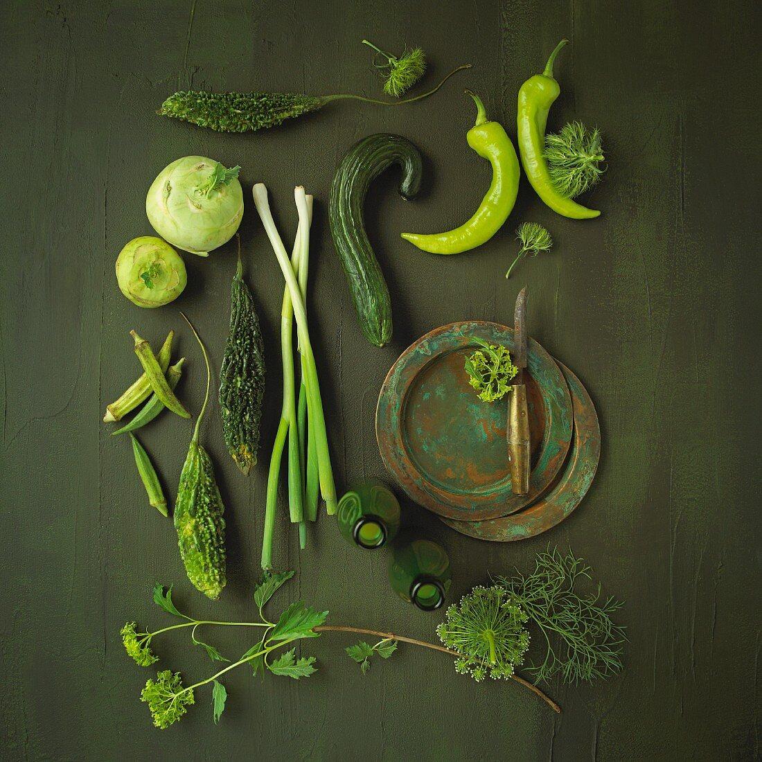 An arrangement of green vegetables and herbs