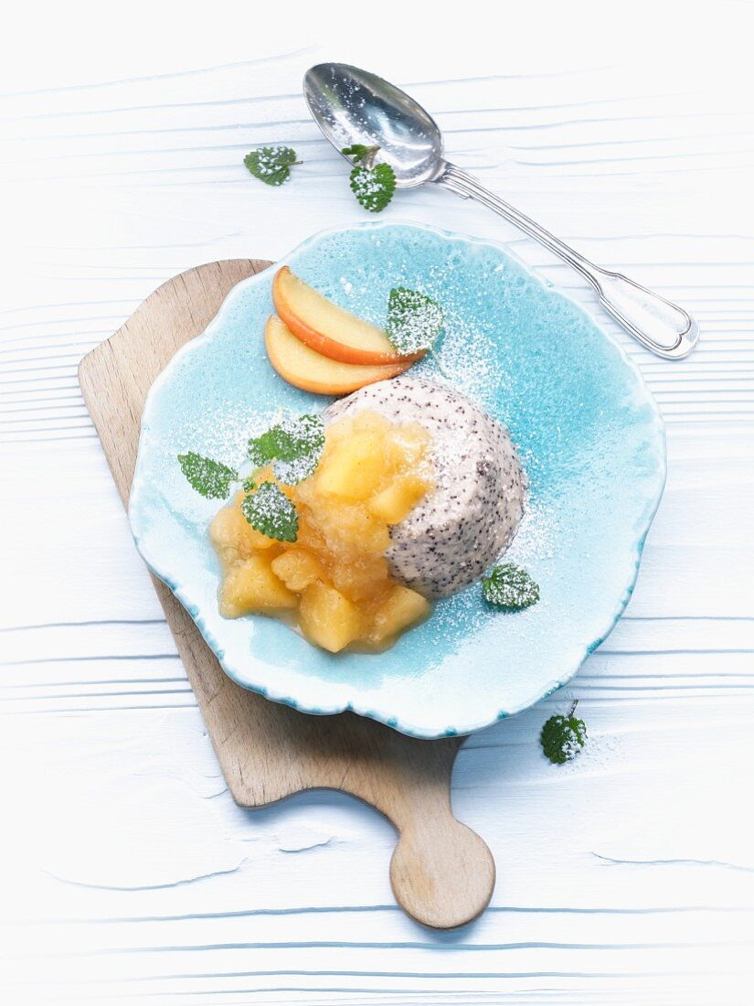 Poppy seed and semolina pudding with stewed apples