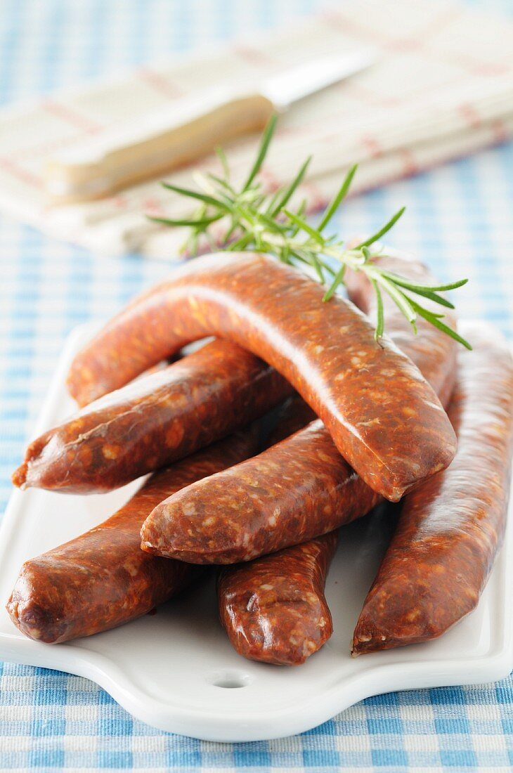 Chorizo sausages on a small porcelain board